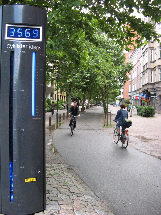 Bicyclists and a bike counter in Malmo - photo by 2headedturtle